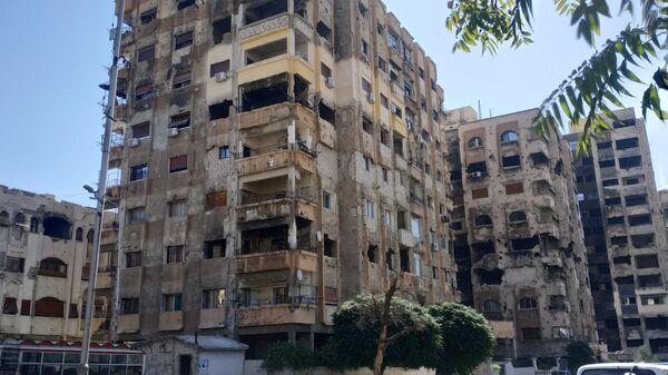 Поврежденные минометным обстрелом дома в районе Барза на востоке Дамаска