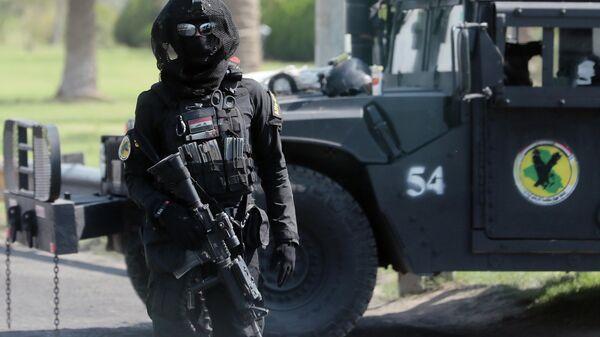 Боец спецподразделения по борьбе с терроризмом на улице Багдада