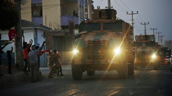 Колонна турецкой военной техники у турецко-сирийской границы. 9 октября 2019