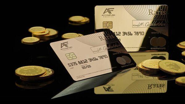 Платежная карта из чистого золота выпушенная Королевским монетным двором