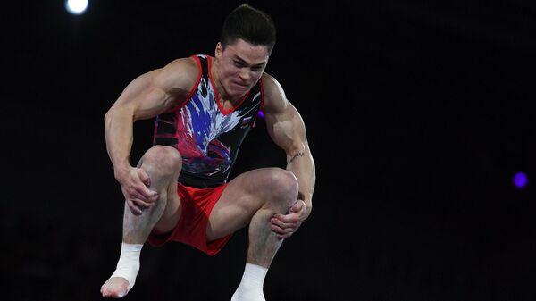 Никита Нагорный (Россия) выполняет опорный прыжок в финале соревнований на чемпионате мира по спортивной гимнастике в Штутгарте.