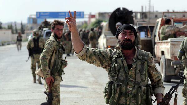 Поддерживаемые Турцией бойцы в городе Телль-Абъяд. 14 октября 2019