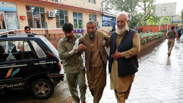 Пострадавший в результате взрыва в мечети в Афганистане. 18 октября 2019