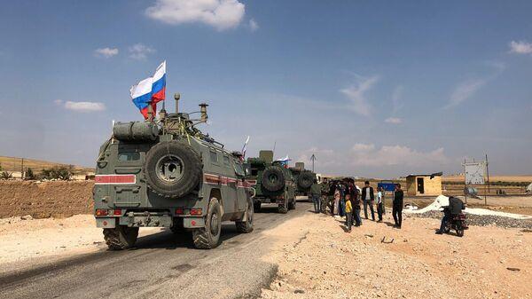 Патруль военной полиции России в районе Кобани на сирийско-турецкой границе