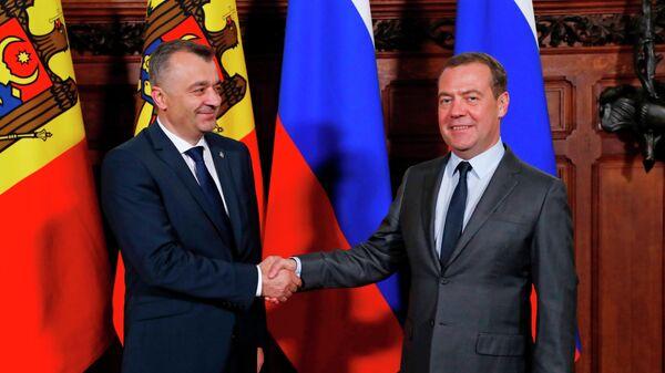 Председатель правительства РФ Дмитрий Медведев и премьер-министр Молдавии Ион Кику во время встречи