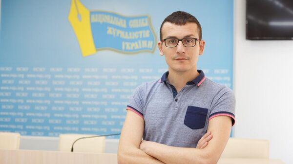 Украинский журналист Сергей Томиленко
