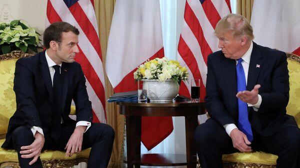 Президент Франции Эммануэль Макрон и президент США Дональд Трамп во время встречи на саммите НАТО в Великобритании. 3 декабря 2019