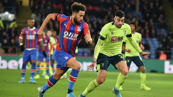 Crystal Palace's English midfielder Andros Townsend vies with Bournemouth's Spanish defender Diego Rico (R) during the English Premier League football match between Crystal Palace and Bournemouth at Selhurst Park in south London on December 3, 2019. (Photo by Glyn KIRK / AFP) / RESTRICTED TO EDITORIAL USE. No use with unauthorized audio, video, data, fixture lists, club/league logos or 'live' services. Online in-match use limited to 120 images. An additional 40 images may be used in extra time. No video emulation. Social media in-match use limited to 120 images. An additional 40 images may be used in extra time. No use in betting publications, games or single club/league/player publications. /