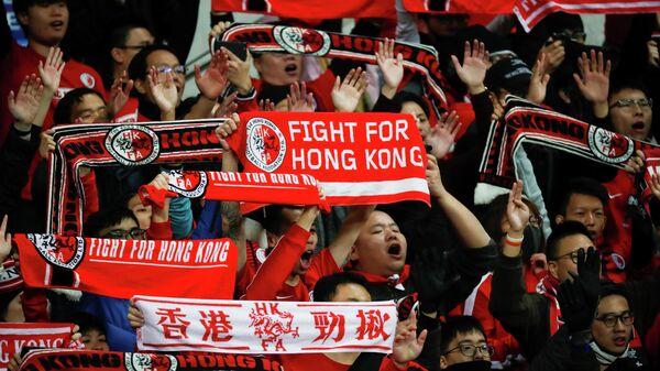 Hongkongers cheer at a soccer match between Hong Kong and China during 2019 EAFF E-1 Football Championship at Busan Asiad Stadium in Busan, South Korea, December 18, 2019.   REUTERS/Kim Hong-Ji