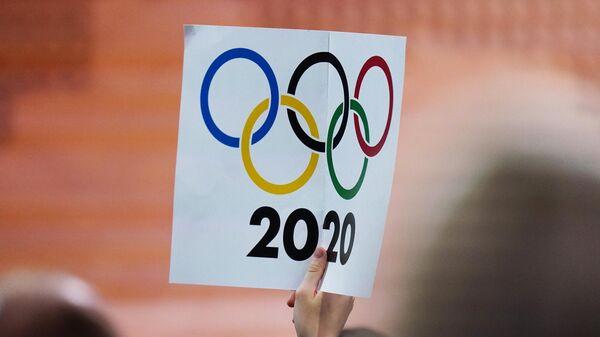 Плакат с олимпийскими кольцами