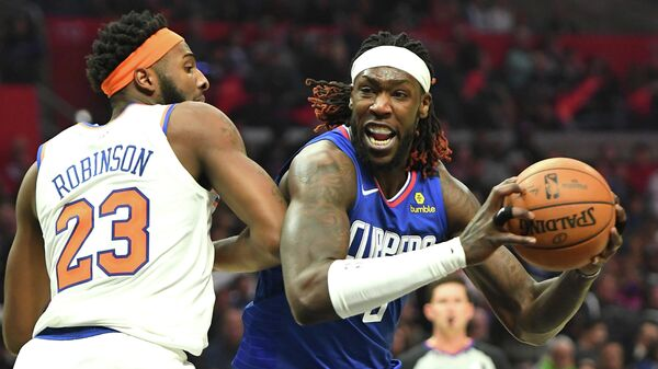 Jan 5, 2020; Los Angeles, California, USA;  New York Knicks center Mitchell Robinson (23) guards Los Angeles Clippers forward Montrezl Harrell (5) as he drives to the basket in the second half of the game at Staples Center. Mandatory Credit: Jayne Kamin-Oncea-USA TODAY Sports