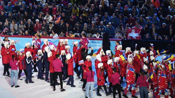 Выход российской делегации во время церемонии открытия III зимних юношеских Олимпийских игр в швейцарской Лозанне.