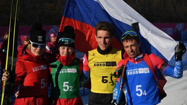 Биатлонисты сборной России Алена Мохова, Анастасия Зенова, Денис Иродов и Олег Домичек (слева направо),