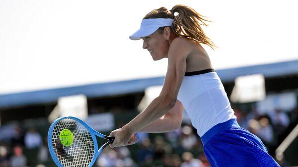 Мария Шарапова в матче против Айлы Томлянович в Мельбурне
