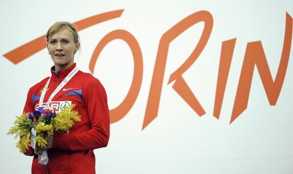 Анна Богданова на награждении победителей в соревнованиях по пятиборью на зимнем ЧЕ по легкой атлетике