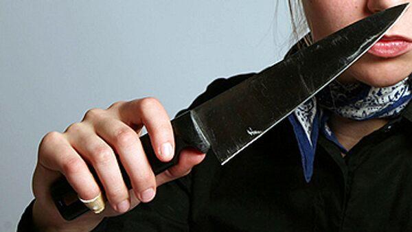 Девушка с ножом. Архивное фото