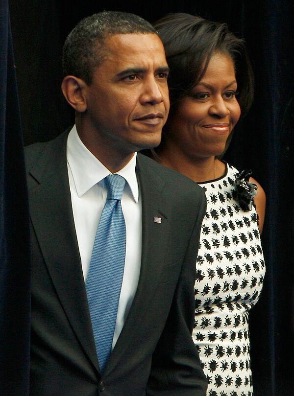 Барак Обама с супругой после выступления в Российской экономической школе