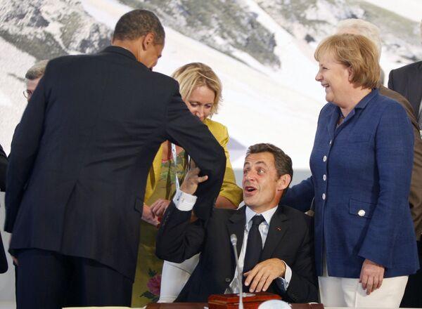 Барак Обама, Николя Саркози и Ангела Меркель на саммите G8 в Аквиле