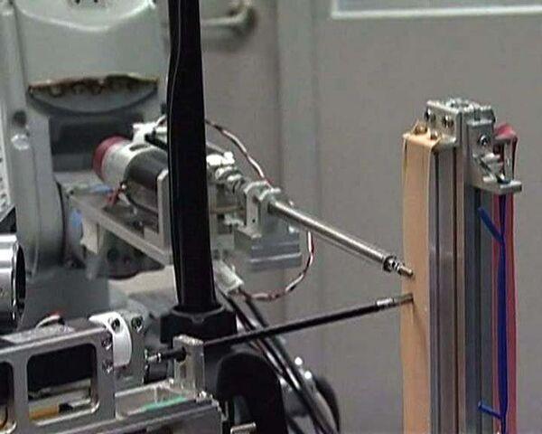 Робот-хирург передает тактильные чувства 25