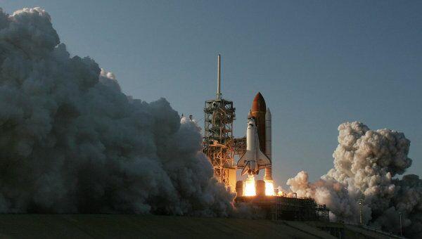 Старт шаттла Discovery с космодрома имени Джона Кеннеди на острове Мерритт в штате Флорида