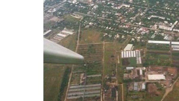 Бескрайние просторы Крыма как на ладони из иллюминатора самолета
