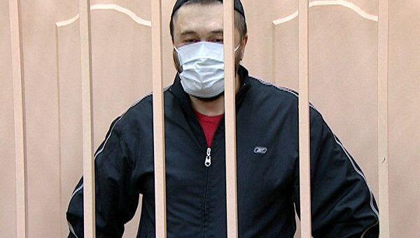 Обвиняемый в убийстве Анны Политковской появился в зале суда в маске