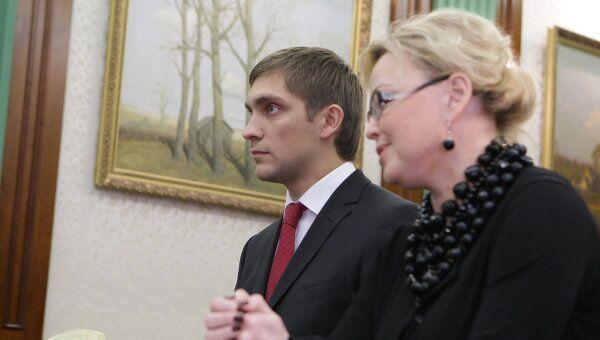 Оксана Косаченко и Виталий Петров (справа налево)