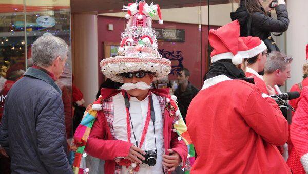 Сотни Санта Клаусов устроили большой предрождественский флэшмоб в Лондоне
