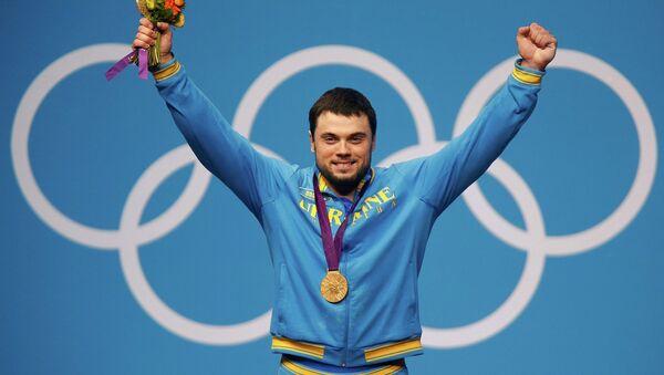 Украинский штангист Торохтий завоевал золото на Олимпиаде в Лондоне