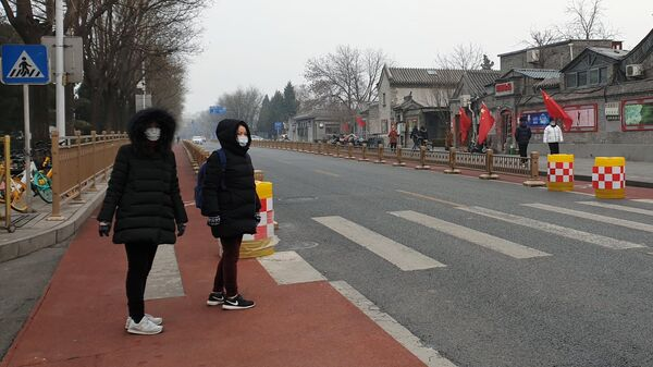 Женщины в медицинских масках в Китае