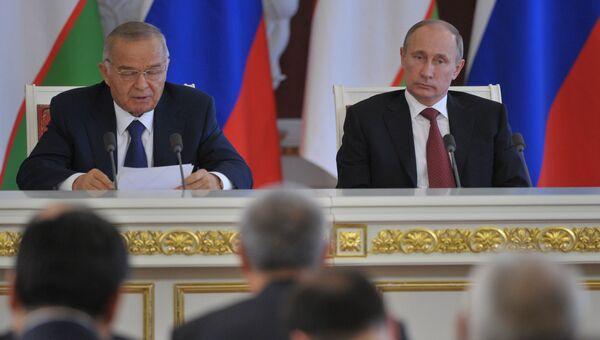 Ислам Каримов и Владимир Путин, архивное фото