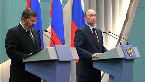 В. Путин встретился с М. Мурси