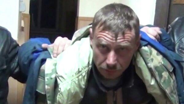 Подозреваемый в убийстве четырех человек в станице Староминская Краснодарского края Евгений Марушко во время задержания оперативниками