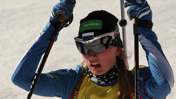 Россиянка Светлана Миронова после финиша в эстафетной гонке в соревнованиях юниоров на молодежном чемпионате мира по биатлону, архивное фото