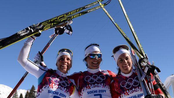 Слева направо: Шарлотт Калла (Швеция), Марит Бьорген (Норвегия), Венг Хейди (Норвегия) после финиша скиатлона в соревнованиях по лыжным гонкам среди женщин на XXII зимних Олимпийских играх в Сочи.