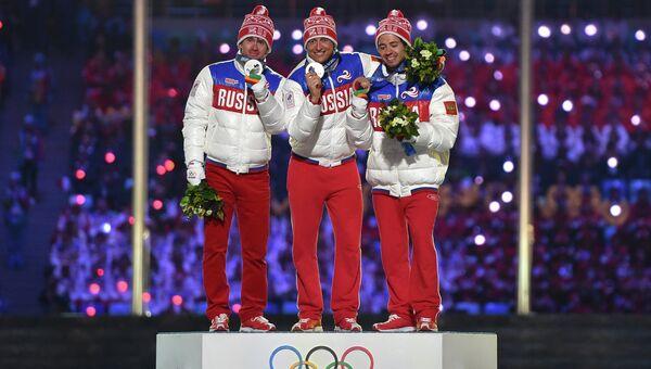 Максим Вылегжанин - серебряная медаль, Александр Легков - золотая медаль, Илья Черноусов - бронзовая медаль