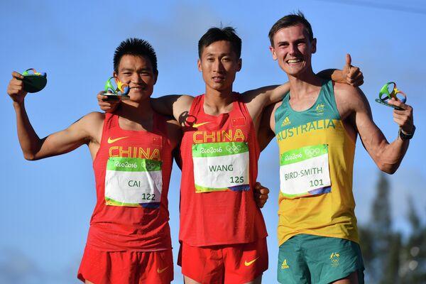 Цай Цзэлинь, Ван Чжэнь и Дейн Бёрд-Смит (слева направо)