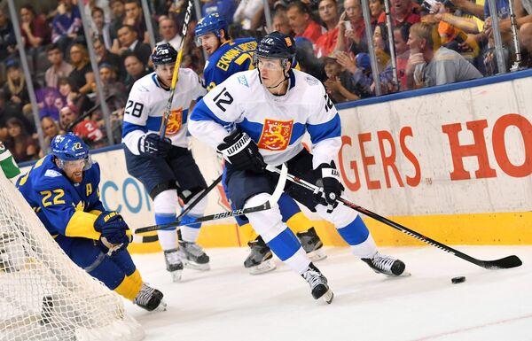 Игровой момент матча Кубка мира Швеция - Финляндия