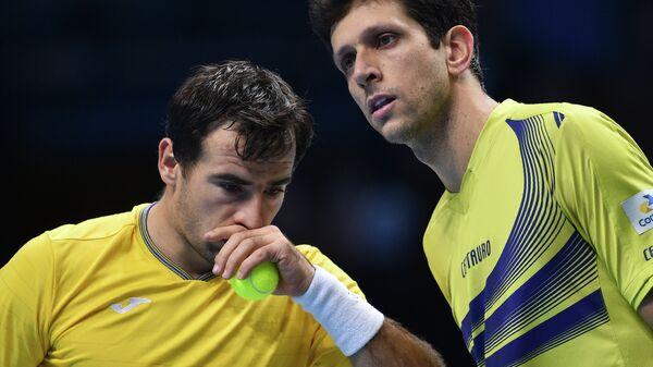 Хорватский теннисист Иван Додиг и бразилец Марсело Мело (слева направо)