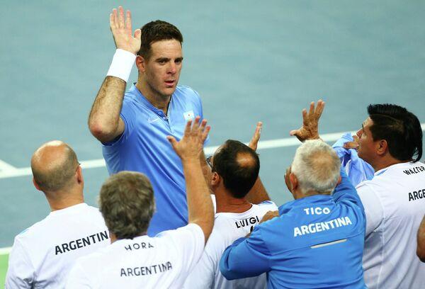 Аргентинский теннисист Хуан Мартин дель Потро (лицом)