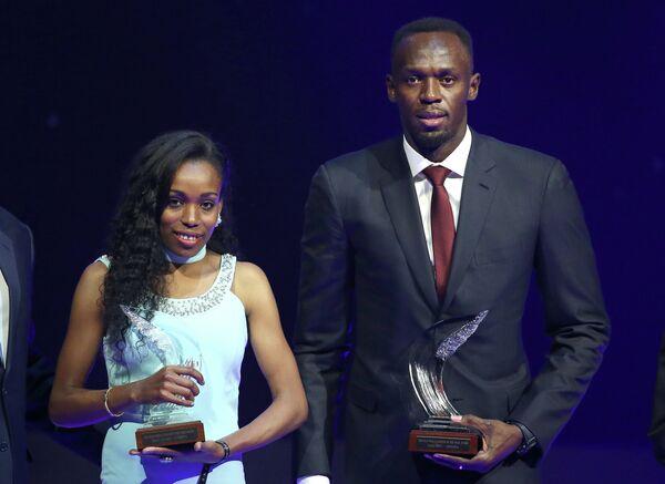 Ямайский спринтер Усэйн Болт и эфиопская бегунья Алмаз Аяна (справа налево)
