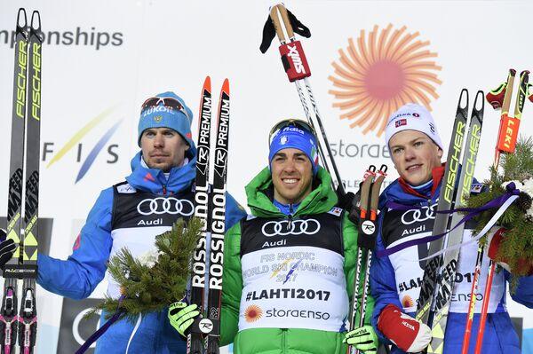 Сергей Устюгов (Россия), Федерико Пеллегрино (Италия) и Йоханнес Хёсфлот Клэбо (Норвегия) (слева направо)