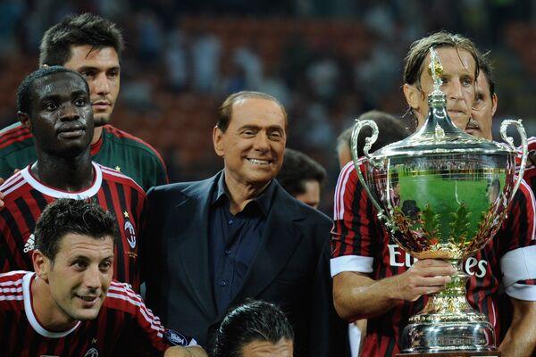 Сильвио Берлускони с футболистами Милана. 2011 год