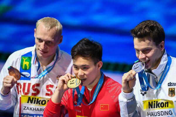 Илья Захаров, Се Сыи и Патрик Хаусдинг (слева направо)