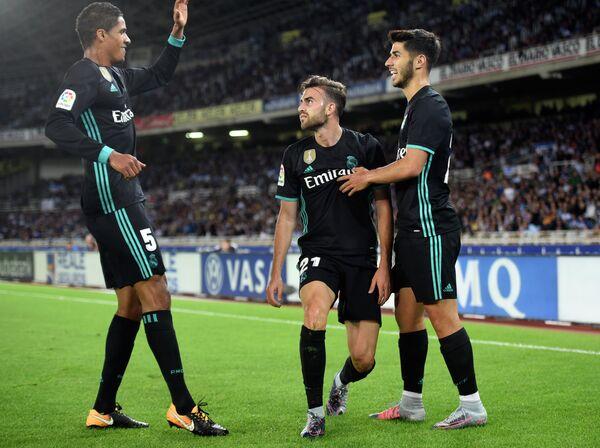 Футболисты Реала Марко Асенсио, Борха Майораль и Рафаэль Варан (справа налево)