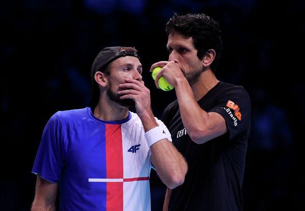 Польский теннисист Лукаш Кубот и бразилец Марсело Мело (слева направо)