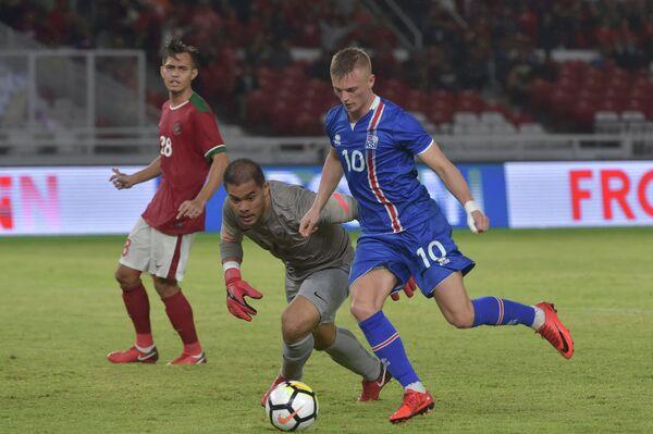 Игровой момент матча Исландия - Индонезия