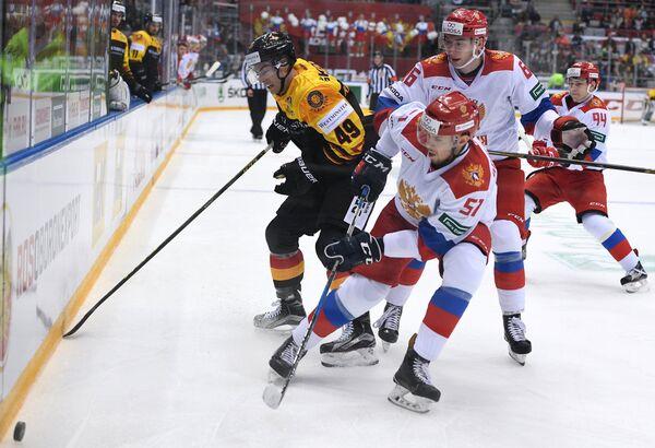 Игровой момент матча олимпийской сборной России и Германии