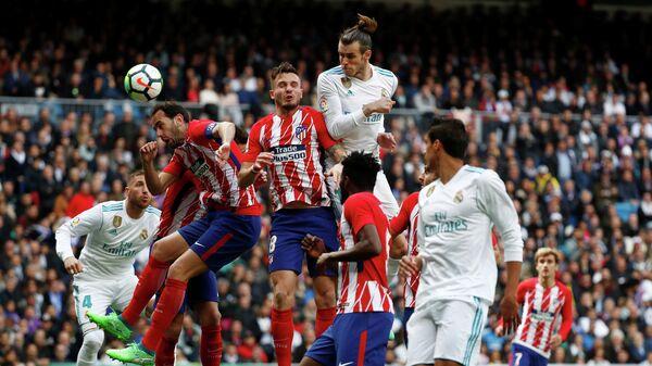Игровой момент матча чемпионата Испании Реал - Атлетико