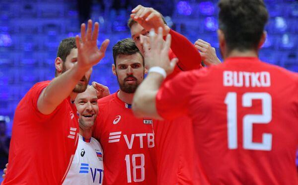 Волейболисты сборной России радуются набранному очку